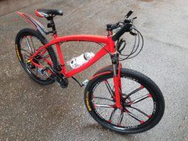 Велосипед не складной 10 лепестков красный